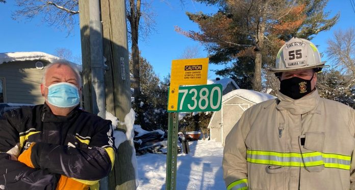 David Snutch and Tony Stong inspect Alternate Power signage for standby generators or solar panels