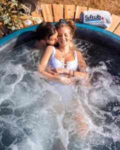 A couple sits in a Softub.