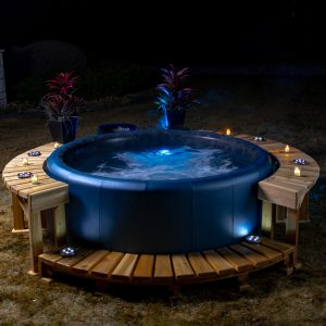 A Softub lit up at night.