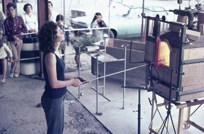 Kathy Ashby demonstrating glassblowing at the Toronto Harbourfront in 1974