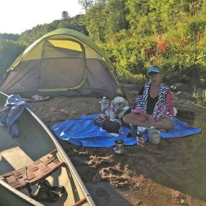 Port Carling teen Cailan Punnewaert and her dog Tinkerbell camping during their 2020 paddle for Aspen Valley