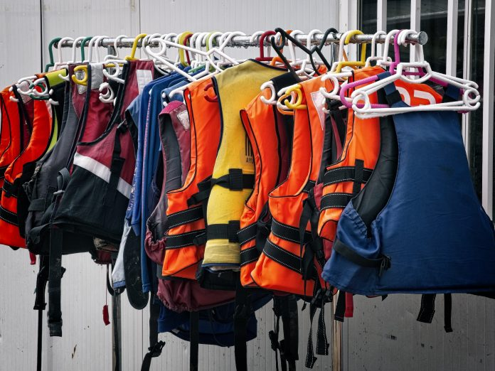 A row of lifejackets. The Lifesaving Society reminds Ontarians to always wear PFDs while boating.