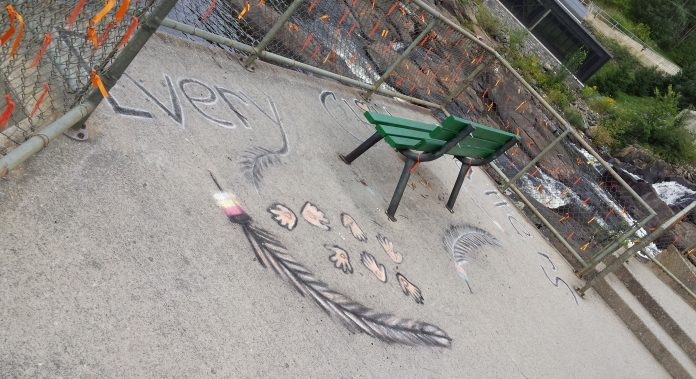 Orange ribbons and chalk art in honour of Indigenous children who died in residential schools
