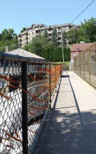 Honouring victims of residential schools: Orange ribbons tied on the fence at Bracebridge Falls